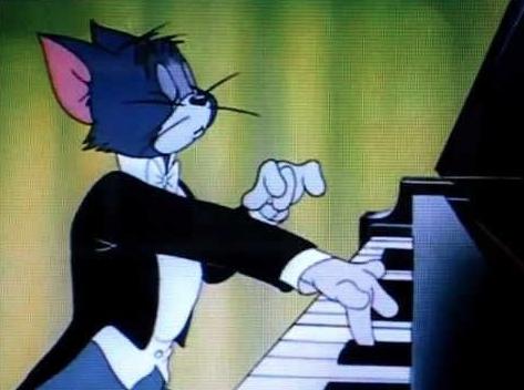 tom playing piano